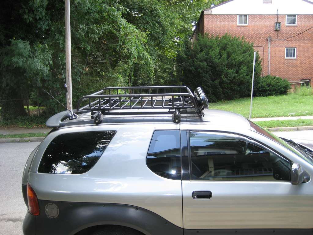 New light rack bar mounts ive got a round bar roof rack they tubes protrude out past the basket about 2 and the light bar is all one piece bolted to the protruding aloadofball Images